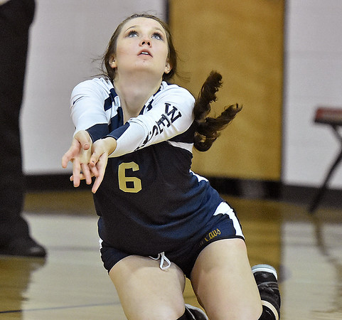 (Brad Davis/The Register-Herald) Greenbrier West's Kaitlin Mullens dives to return a ball against Greater Beckley Christian Wednesday night in Prosperity.
