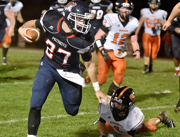 (Brad Davis/The Register-Herald) Independence's Logan Kelly carries the ball during the Patriots' win over Summers County Friday night in Coal City.