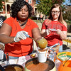 (Brad Davis/The Register-Herald) Oak Hill residents Shelly Nicholas, left, prepares a large cup of their chili for the judges as helper Ally Phillips waits to put a lid on it during the Fayetteville Chili Cook-Off Saturday afternoon on Court Street.