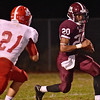 (Brad Davis/The Register-Herald) Woodrow Wilson's Micah Hancock carries the ball against Parkersburg Friday night.