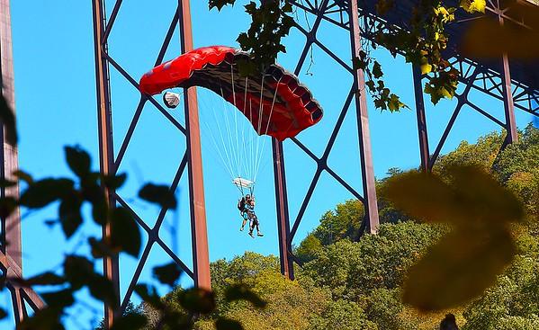 Tandem jumper jumps off the New Gorge Bridge during Bridge Day in Fayetteville.<br /> (Rick Barbero/The Register-Herald)
