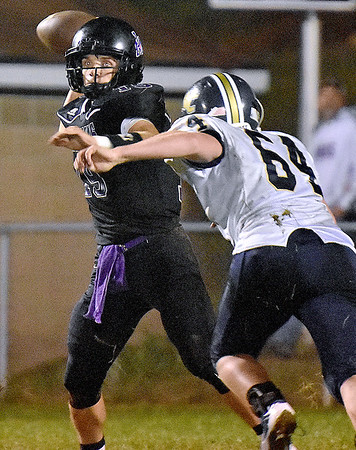 (Brad Davis/The Register-Herald) James Monroe's Evan Beasley throws against Nicholas County Friday night in Lindside.
