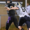 (Brad Davis/The Register-Herald) James Monroe's Evan Beasley throws against Nicholas County Friday night in Lindside.