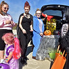 (Brad Davis/The Register-Herald) Independence Middle School Art Club students (from left) Elizabeth Royal, Kylie Stone and Trista Hampton marvel at some of the costumed youngsters as they pass by during Tailgate Halloween Saturday morning atop Beckley's Intermodal Gateway.