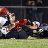 (Brad Davis/The Register-Herald) Liberty QB Jacob Bailey is sacked by the Indy defense Friday night in Coal City.