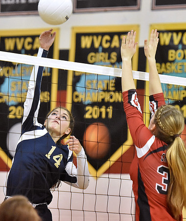 (Brad Davis/The Register-Herald) Greenbrier West's Skyler Snuffer leaps to hit the ball as Greater Beckley Christian's Lydia Jordan tries to block it Wednesday night in Prosperity.