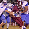 (Brad Davis/The Register-Herald) Woodrow Wilson's Logan Cook is taken down by a gang of Cougar defenders as he carries the ball during the Flying Eagles' game against Capital Friday night at Van Meter Stadium.