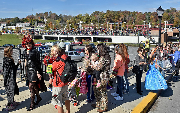 (Brad Davis/The Register-Herald) A massive line of costumed characters and their families wait patiently through long lines that stretched around taround the facility at times during Tailgate Halloween Saturday morning atop Beckley's Intermodal Gateway.