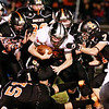 A group of Summers County defenders bring down Webster County's Chaee Rose (3) during the first quarter of their football game Friday in Hinton.  (Chris Jackson/The Register-Herald)