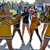 (Brad Davis/The Register-Herald) Young WVU fans Emma Taylor (right), 9, and Lexi Thomas, 8, get the chance to perform routines with the Mountaineer cheerleaders during the university's Gold & Blue Weekend Family Street Fest Saturday morning at Jim Word Memorial Park.