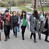 "(Brad Davis/The Register-Herald) A group of friends and family led by his wife Tammy (middle in green), son Chris (behind Tammy at left) and daughter Ann Elizabeth (right of Tammy), among others, make their way up what's now known as Mel Hancock Way prior to a brief ceremony for the late Beckley resident Saturday afternoon. Several friends and relatives of Mel's attended a brief and somber ceremony as they and mayor Rob Rappold paid tribute by renaming ""A"" Street after him."