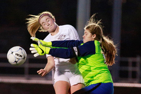 Woodrow Wilson's Katie Sweeney (7) attempts to score form a long pass as Princeton's goalkeeper deflects the attempt during their Class AAA, Region 3, Section 1 Tournament in Beckley on Tuesday. (Chris Jackson/The Register-Herald)