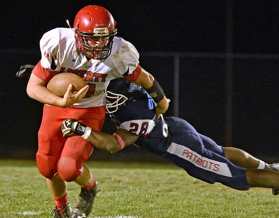 (Brad Davis/The Register-Herald) Liberty's Eric Workman and Indy's Marcus Guy Friday night in Coal City.