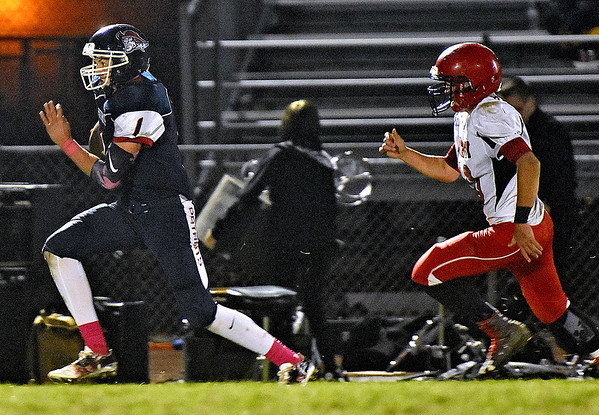 (Brad Davis/The Register-Herald) Independence's Tyler Haga breaks loose during the Patriots' win over the Raiders Friday night in Coal City.