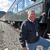 (Brad Davis/The Register-Herald) Tom Backus, Road Foreman of Engines for Amtrak, boards the New River Train before it heads back to Huntington during Railroad Days in Hinton Sunday afternoon.