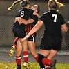 (Brad Davis/The Register-Herald) PikeView's Kari Shrewsbury (#6) and Callie Lamb embrace following a first half goal against Oak Hill Wednesday night in Oak Hill.