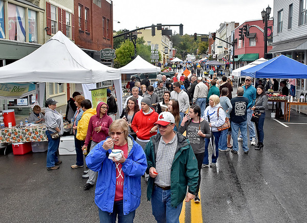 (Brad Davis/The Register-Herald) Early rain slowed the start of this year's TOOT, but the crowd picked up as the rain tailed off Saturday in Lewisburg.