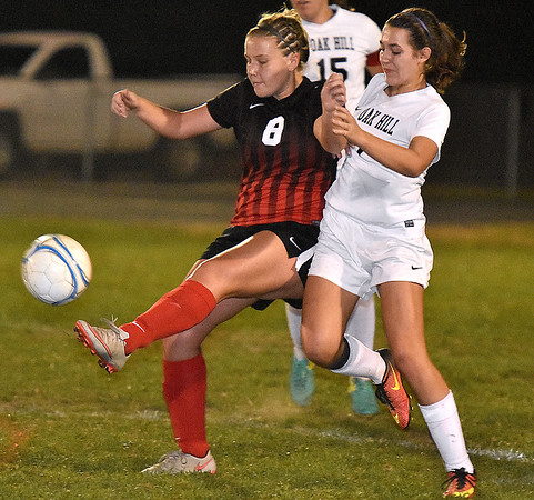 (Brad Davis/The Register-Herald) PikeView's Emilee Nelson battles for possession with Oak Hill's Ariana Hunt Wednesday night in Oak Hill.