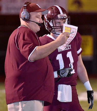 (Brad Davis/The Register-Herald) Head coach Street Sarrett gives Logan Cook the next play during their game against Capital Friday night.