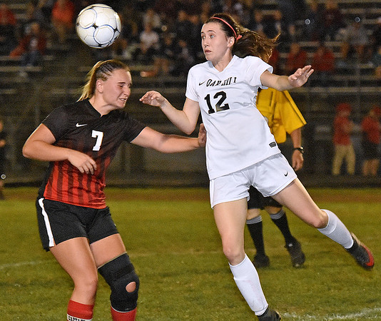 (Brad Davis/The Register-Herald) Oak Hill's Courtney Smith heads the ball downfield before PikeView's Maya Klein can get to it Wednesday night in Oak Hill.