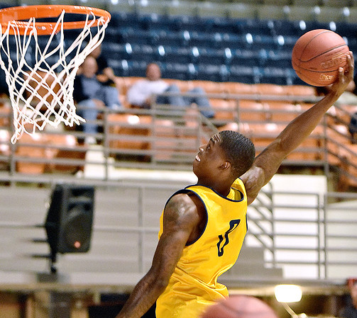 (Brad Davis/The Register-Herald) WVU's Teyvon Myers throws down a dunk during the Mountaineers' practice Friday night at Beckley-Raleigh County Convention Center.