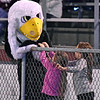 (Brad Davis/The Register-Herald) A pair of young Woodrow Wilson fans try to cheer up a slightly bummed Flying Eagle mascot during their game against Capital Friday night at Van Meter Stadium.