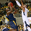 (Brad Davis/The Register-Herald) WVU Tech's Junior Arrey drives to the basket during the Mountaineers' exhibition game with the Golden Bears Saturday night at the Beckley-Raleigh County Convention Center.