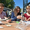 (Brad Davis/The Register-Herald) Shady Spring Middle School students (from left) WIll Chouinard Aura Matics and Alina Mackowiak build their rockets during the Rockets Boys Festival Saturday afternoon at the Exhibition Coal Mine.