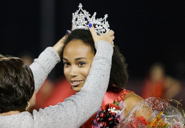 Homecoming Queen, Daniel Richardson receives her crown during the halftime ceremony. Chad Foreman for the Register-Herald.