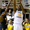 (Brad Davis/The Register-Herald) WVU's Lamont West shoots for three during the Mountaineers' exhibition game with the Golden Bears Saturday night at the Beckley-Raleigh County Convention Center.