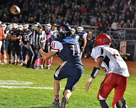 (Brad Davis/The Register-Herald) Jacob Hart's interception during Indy's game against Liberty Friday night in Coal City.