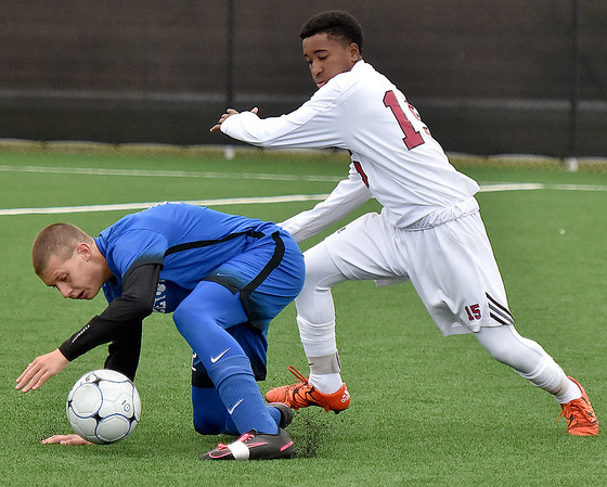 (Brad Davis/The Register-Herald) Woodrow Wilson's Ben Anderson pressures Princeton's Dante Punturi during the Flying Eagles' win over the Tigers Saturday afternoon at the YMCA Paul Cline Memorial Sports Complex.
