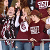 (Brad Davis/The Register-Herald) Woodrow Wilson students jam along with the marching band during the Flying Eagles' home game against Parkersburg Friday night.