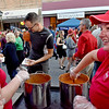 (Brad Davis/The Register-Herald) Venus Lounge employees Melissa Hagy, right, and Leann Kennedy keep the chili flowing as tasters pass by during Chili Night Saturday evening in uptown Beckley.