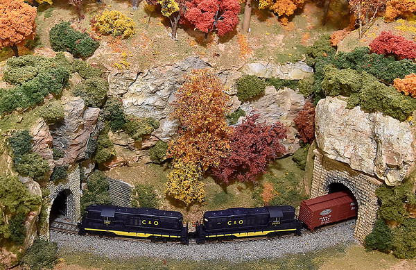(Brad Davis/The Register-Herald) A model train makes its way through tunnels in a fall scene inside the museum during Railroad Days in Hinton Sunday afternoon.