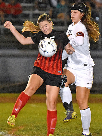 (Brad Davis/The Register-Herald) PikeView's #15 battles for possession with Oak Hill's Julia Ivey Wednesday night in Oak Hill.
