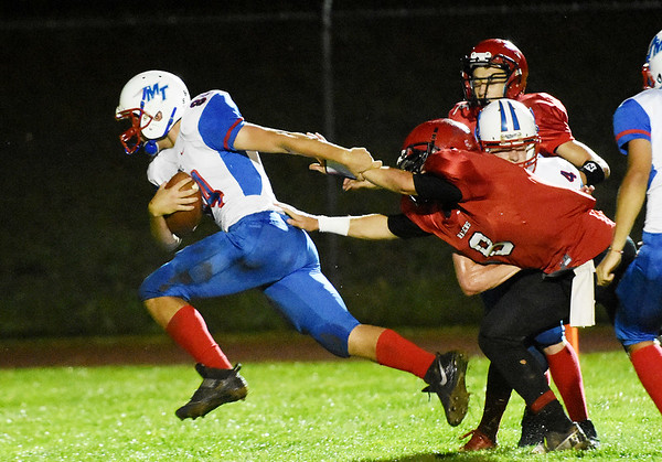Midland Trail's Noah Minor (84) breaks a tackle from Liberty's Jacob Bailey (8) for a touchdown run during the first quarter of their football game Friday in Glen Daniel. (Chris Jackson/The Register-Herald)