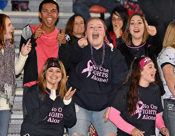 (Brad Davis/The Register-Herald) Indy students notice the camera as they react to events on the field during the Patriots' home game against Liberty Friday night in Coal City.