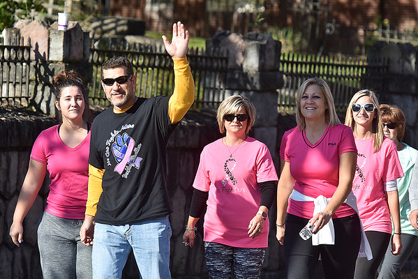 (Brad Davis/The Register-Herald) Participants approach the home stretch as they make their way up Kanawha Street on a three-mile Breast Cancer Awareness Walk from the VA Medical Center off Robert C. Byrd Drive to the Beckley Veterans Center on Johnstown Road Saturday morning. The 2nd annual walk was escorted along the way by Beckley Police and Jan-Care Ambulance.