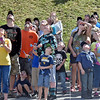 (Brad Davis/The Register-Herald) Spectators watch rocket fly through the sky during the Rocket Boys Festival Saturday.