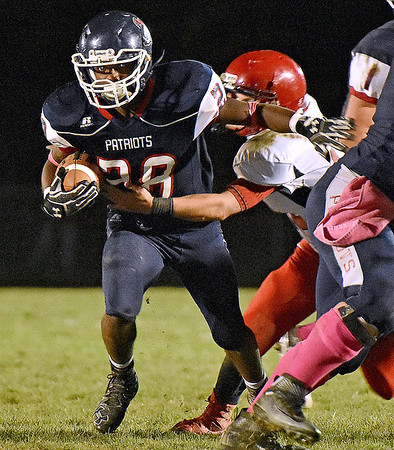 (Brad Davis/The Register-Herald) Independence running back Marcus Guy carries the ball during the Patriots' win over the Raiders Friday night in Coal City.