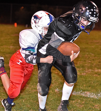 (Brad Davis/The Register-Herald) Beckley-Stratton's Tyler Harper, right, carries the ball as Independence's Eden Addair tries to bring him down during the Bulldogs' win over the Patriots Thursday night at Woodrow Wilson's Van Meter Stadium.