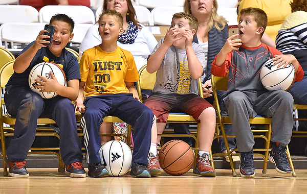 (Brad Davis/The Register-Herald) Enthusiastic young Mountaineer fans can barely contain themselves as they react to a slam dunk during WVU's practice Friday night at Beckley-Raleigh County Convention Center.