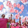 (Brad Davis/The Register-Herald) Valley College students and others release over a hundred pink balloons into the air during a breast cancer awareness month event Wednesday afternoon at Jim Word Memorial Park. Around 25 students and a few firefighters from Mt. Hope and Clear Creek fire departments made the walk all the way from the school's location beside Ollie's, up Kanawha Street to the park and released a balloon for each friend or family member affected by the disease.