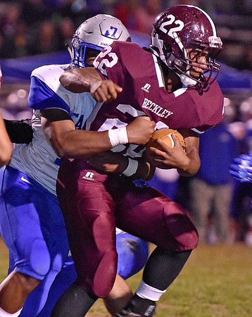 (Brad Davis/The Register-Herald) Woodrow Wilson's Meeko Harris carries the ball during the Flying Eagles' game against Capital Friday night at Van Meter Stadium.
