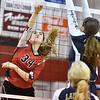(Brad Davis/The Register-Herald) Greater Beckley Christian's Lydia Jordan hits the ball as Greenbrier West's Skyler Snuffer tries to block it Wednesday night in Prosperity.
