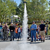 (Brad Davis/The Register-Herald) Rocket Boy Billy Rose, second from right, hits the launch buttom and sends a rocket skyward during the Rocket Boys Festival Saturday afternoon at the Exhibition Coal Mine. Fellow Rocket Boy Homer Hickam looks on at second from left.
