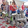 (Brad Davis/The Register-Herald) Attendees marvel at metal train on display and available as a raffle prize at The Berry Basket primitive Shop's booth during Railroad Days in Hinton Sunday afternoon.
