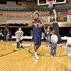 (Brad Davis/The Register-Herald) WVU's Daxter Miles Jr. goofs around with young fans on the court following the Mountaineers' practice Friday night at Beckley-Raleigh County Convention Center.