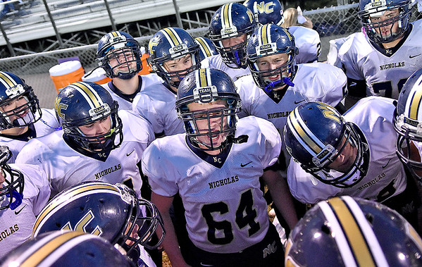 (Brad Davis/The Register-Herald) Nicholas County's Logan Cole (#64) gets his teammates fired up for James Monroe Friday in Lindside.